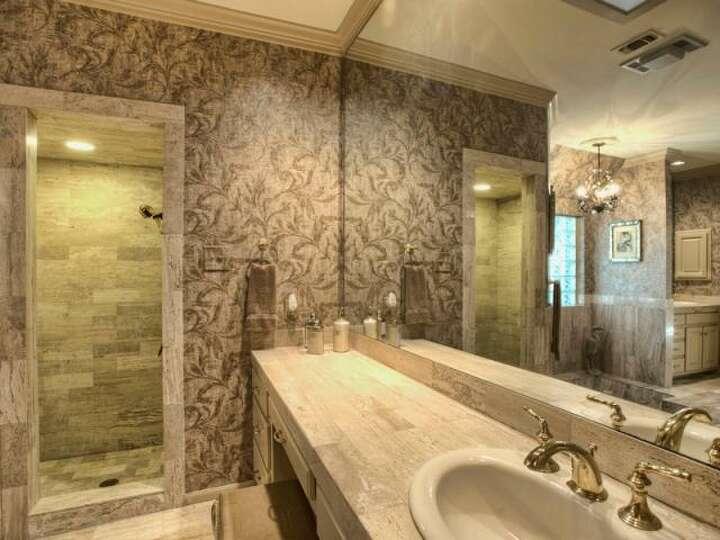 The master bathroom has a large mirror ample vanity space for Bathroom mirrors san antonio