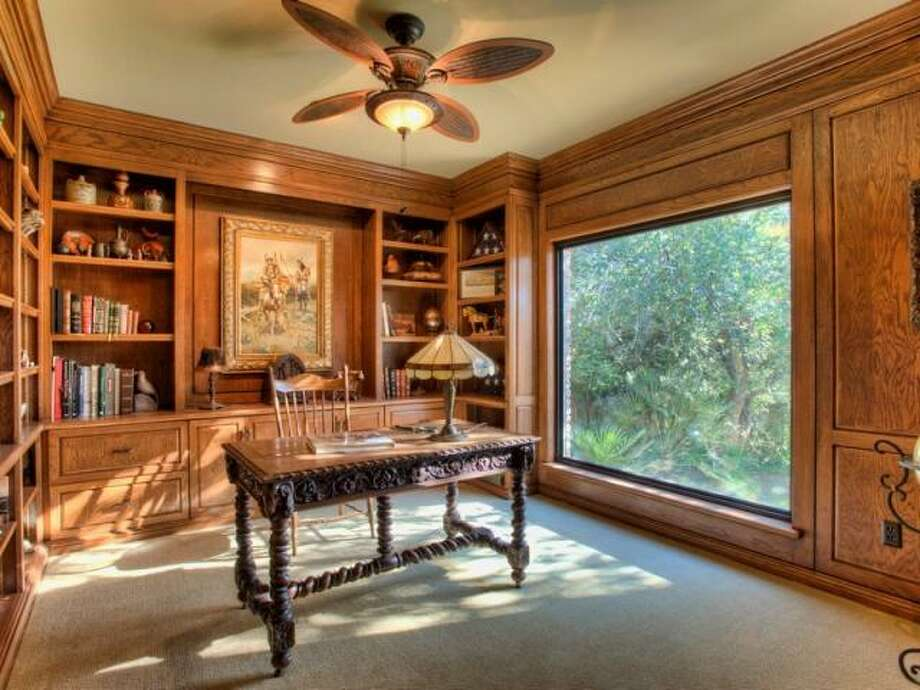 Built-in shelving allows for the study to provide a clean office environment or home library. (Kuper Sotheby\\\'s International Realty)