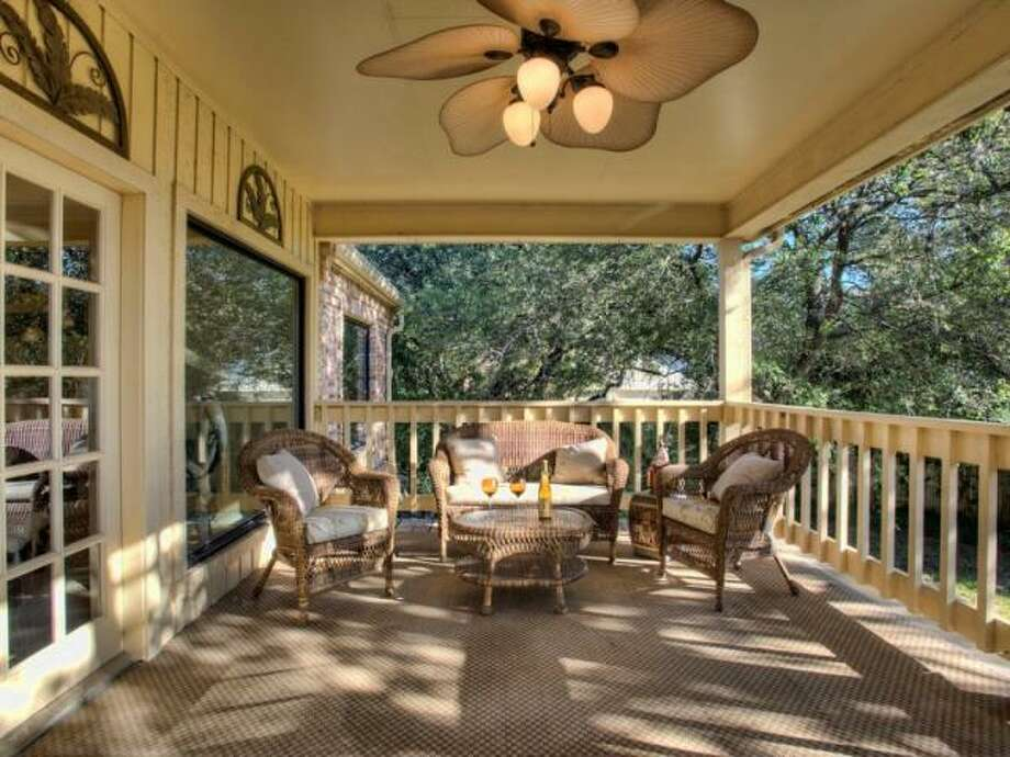 Just outside the den is the balcony of the second floor. There is a ceiling fan to cool off on hot days and views of the lush backyard. (Kuper Sotheby\\\'s International Realty)