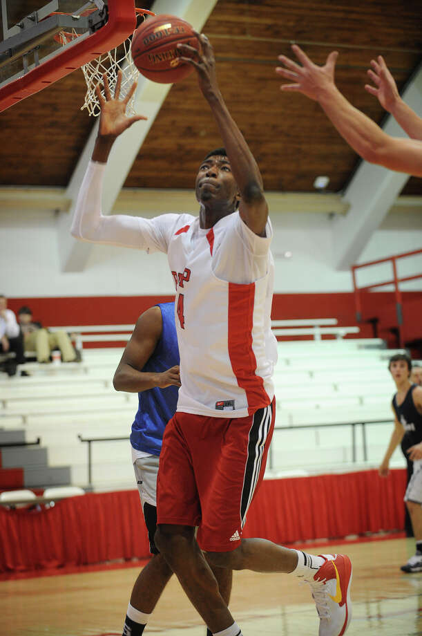 Fairfield Prep's Pascal Chukwa reaches high for a rebound during a scrimmage versus Staples at Alumni Hall in Fairfield on Monday, December 3, 2012. Photo: Brian A. Pounds / Connecticut Post