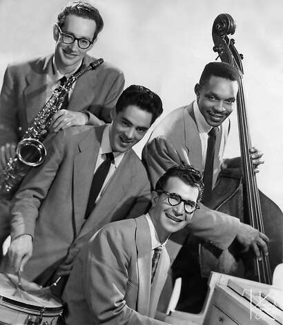Dave Brubeck (front) worked with a black bass player, Eugene Wright (right), in the '50s, even though it led promoters to cancel many of the band's gigs. Photo: Chronicle File Photo / SF