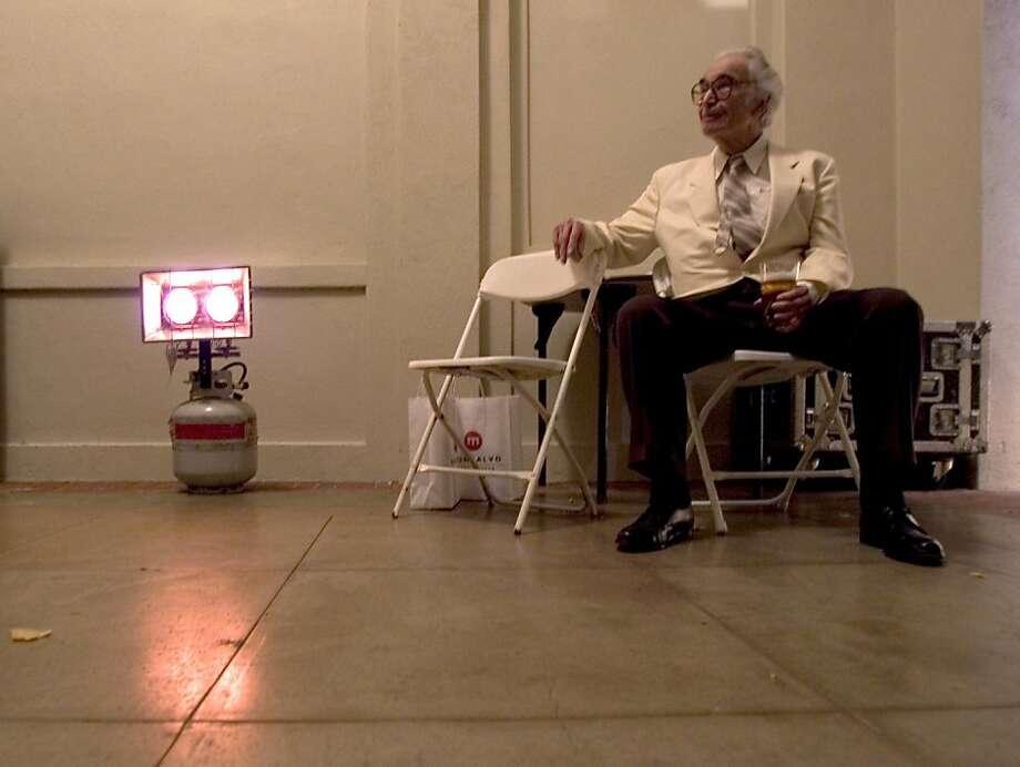 At intermission at Villa Montalvo, Dave Brubeck rests near a propane heater backstage. Photo: Kim Komenich, SFC
