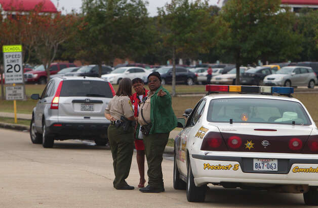 North Shore High School is seen after a shooting occurred Wednesday, Dec. 5, 2012, in Houston. Police say a high school student shot himself after being taken into custody for having a gun at the school when he allegedly shot himself with another gun while in custody. Photo: Cody Duty, Houston Chronicle / © 2012 Houston Chronicle