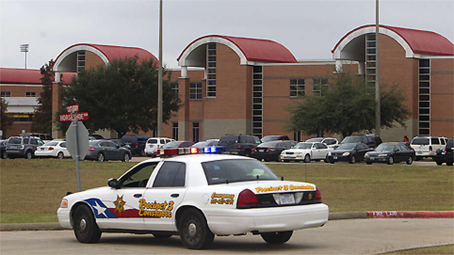 North Shore High School is seen after a shooting occurred Wednesday, Dec. 5, 2012, in Houston. Police say a high school student shot himself after being taken into custody for having a gun at the school when he allegedly shot himself with another gun while in custody. Photo: Cody Duty, . / © 2012 Houston Chronicle