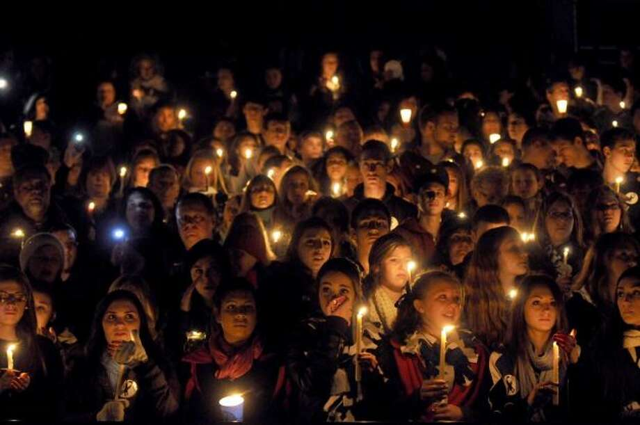 Thousands join in a candlelight vigil and memorial service for the Shen crash victims at Shenendehowa High School in Clifton Park, NY Tuesday Dec. 4, 2012. Shen students Chris Stewart and Deanna Rivers died in the crash with Matt Hardy and Bailey Wind being seriously injured.(Michael P. Farrell/Times Union)