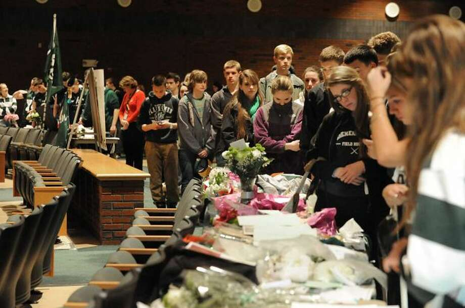 Students and faculty line up at a memorial set up in the auditorium at Shenendehowa High School Monday Dec. 3, 2012 in Clifton Park, N.Y. The memorial is set up for students to grieve together, to leave notes and flowers to honor the lives of Chris Stewart and Deanna Rivers, and to offer wishes for the emotional and physical recovery of Matt Hardy and Bailey Wind. (Lori Van Buren / Times Union)
