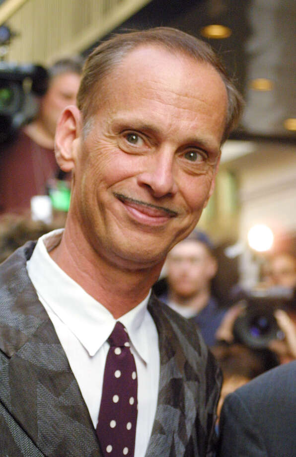 "John Waters arrives at  the Neil Simon Theatre for the premiere of the Broadway musical ""Hairspray,"" Thursday, Aug. 15, 2002 in New York. ""Hairspray,"" is based on Waters' 1988 movie about an overweight girl in Baltimore who wants to become a regular on an afterschool pop music television show. (AP Photo/Tina Fineberg) Photo: TINA FINEBERG"