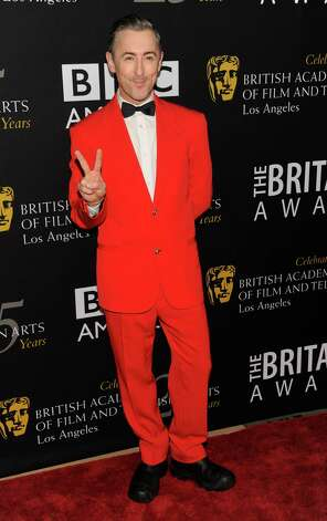 Host Alan Cumming poses at the BAFTA Los Angeles 2012 Britannia Awards at the Beverly Hilton Hotel on Wednesday, Nov. 7, 2012, in Beverly Hills, Calif. (Photo by Chris Pizzello/Invision/AP) Photo: Chris Pizzello / Invision