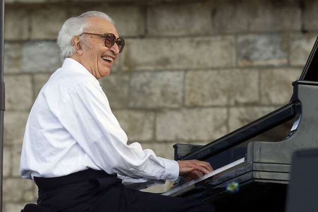 ** FILE ** Dave Brubeck performs with his band, The Dave Brubeck Quartet, at the JVC Jazz Festival in Newport, R.I., on Aug. 10, 2003. Brubeck returns Saturday, Oct. 4, 2003, to the 1,200-seat Finney Chapel at Oberlin College in Oberlin, Ohio, where 50 years ago he recorded the landmark album Jazz at Oberlin, which was credited with taking jazz from nightclubs to college students, a loyal audience that would grow with the artists. (AP Photo/Stew Milne, file) (AP)
