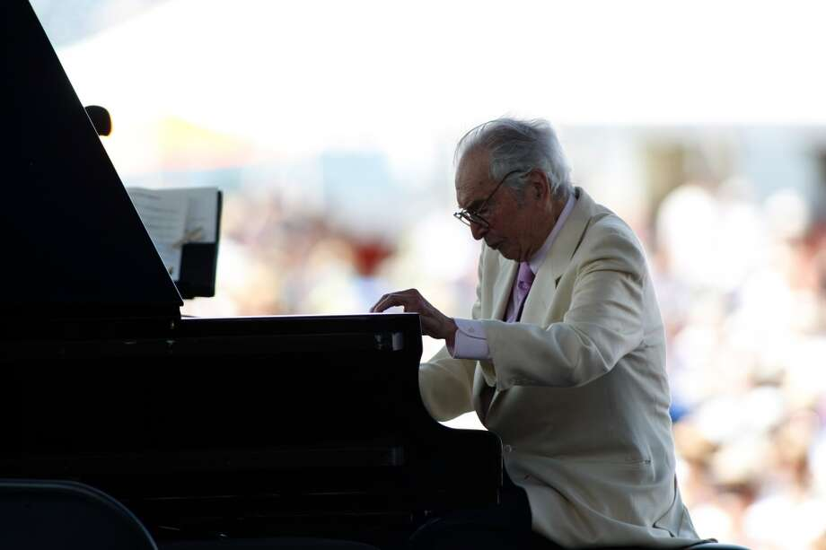FILE - In this Aug. 8, 2010 file photo, Dave Brubeck plays at the CareFusion Newport Jazz Festival in Newport, R.I. Brubeck, who turns 90 on Monday, Dec. 6, 2010, will celebrate the day by gathering in the family home in the Connecticut woods to watch Turner Classic Movies broadcast Dave Brubeck: In His Own Sweet Way, a new documentary directed by Bruce Ricker, produced by Clint Eastwood and narrated by Alec Baldwin. (AP Photo/Joe Giblin, File) (AP)