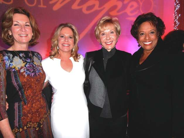 At the Faces of Hope dinner, Gayle Embrey, from left, celebrates the successes of Haven for Hope with photographer Marie Langmore, Deborah Amini and event chairwoman Priscilla Hill-Ardoin. Photo: Nancy Cook-Monroe, For The Express-News