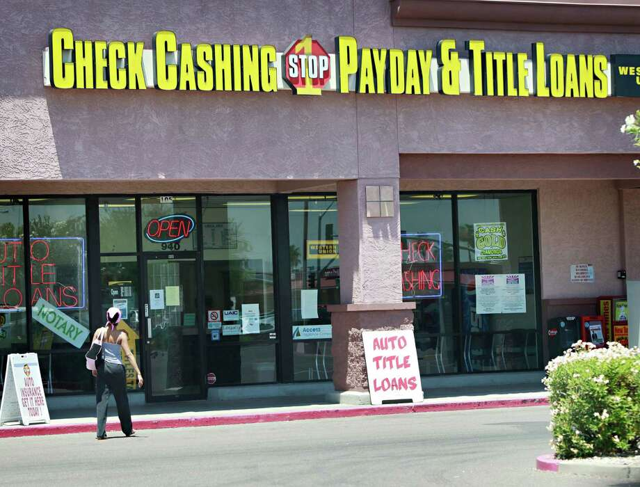 A customer enters a pay day loan store Monday, June 28, 2010 in Chandler, Ariz. Payday loan customers will have to look elsewhere for credit options when the law allowing the industry to operate in Arizona expires on Thursday. Photo: Matt York, AP / AP