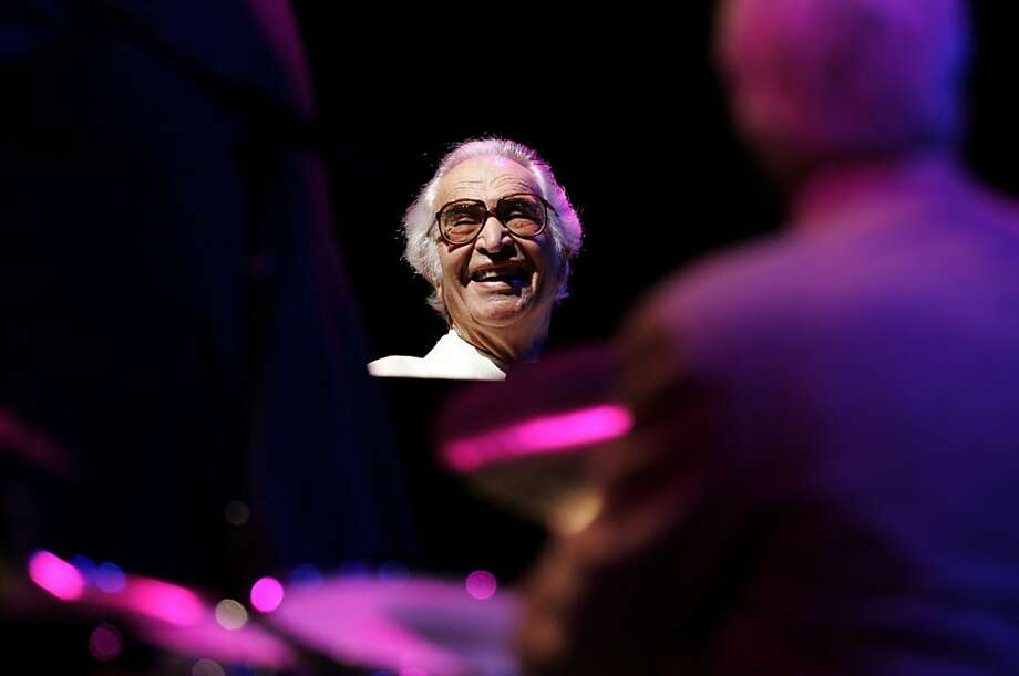 Dave Brubeck reacts to a Bobby Militello sax solo at Villa Montalvo during a performance on Aug. 26, 2005. San Francisco photographer Kim Komenich joined jazz legend Dave Brubeck, 85 at the time, and his wife Iola and his quartet (Bobby Militello sax, Michael Moore, bass and Randy Jones, drums) on a two-day tour through the Central Valley, where he was raised. Brubeck's gigs include Villa Montalvo in Saratoga on Aug. 26th, and Outdoor Grove in Sacramento on Aug. 27. Photo: Kim Komenich, SFC