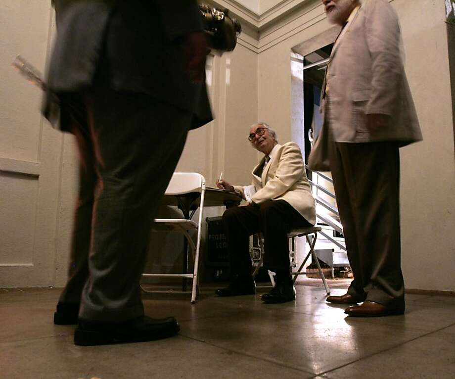 Dave Brubeck, seated, talks with Bobby Militello, left, and Michael Moore, right, backstage at Villa Montalvo. Photo: Kim Komenich, SFC