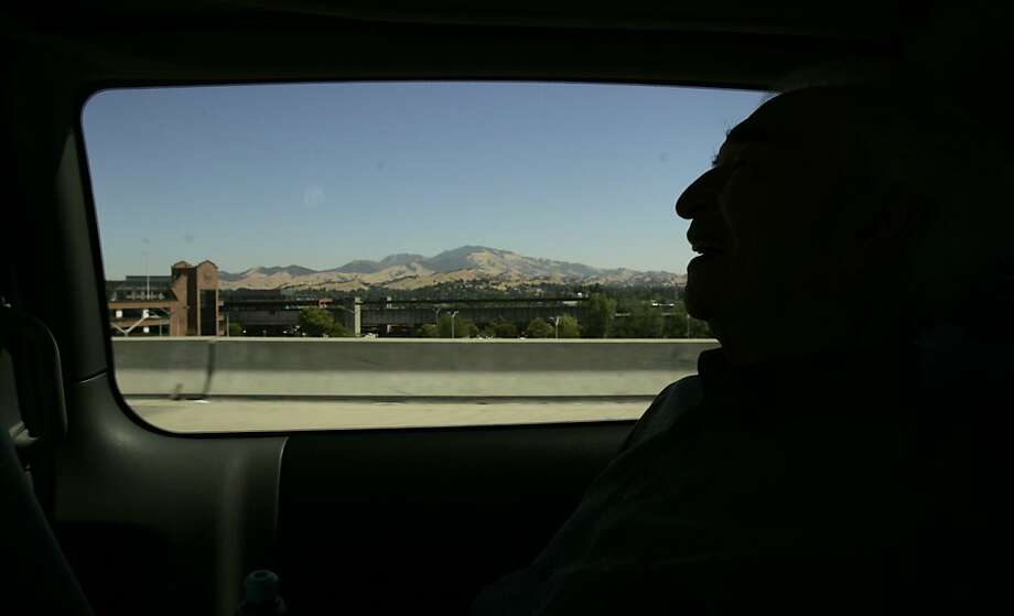 Dave Brubeck (in silhouette) is a passenger in a van as it passes through Concord, Calif. in 2005, where he was born on Dec. 6, 1920.That's Mt. Diablo in the distance. Photo: Kim Komenich, SFC