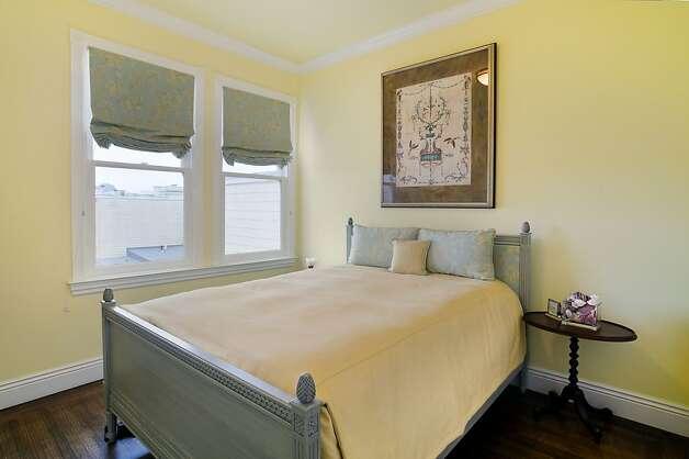 The condo has three bedrooms, which includes this spacious room with hardwood floors. Photo: Reflex Imaging