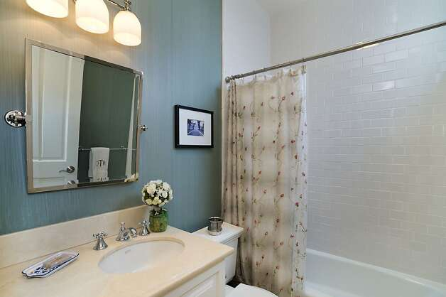 The Presidio Heights condo has two bathrooms. Photo: Reflex Imaging