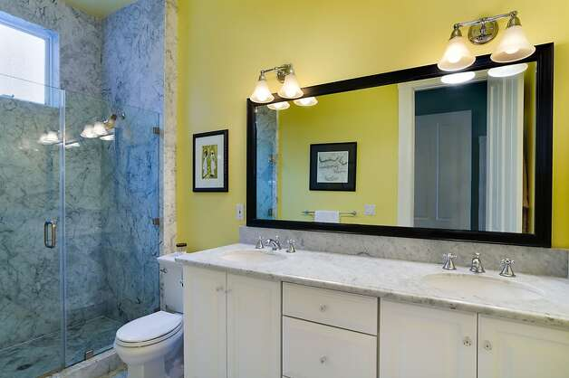 The master bathroom features dual sinks and a walk-in shower. Photo: Reflex Imaging
