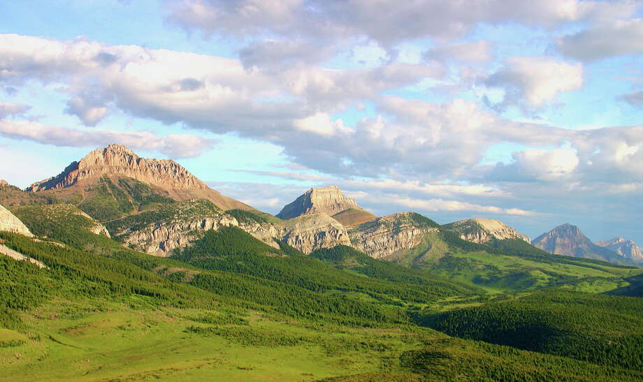 "Lonely Planet highlighted a mix of locations that are well-known and less-popular, urban and remote, spread out around the continent, and beyond for its 2013 list of top 10 U.S. travel destinations. We start with No. 10, Glacier National Park, Mont.Lonely Planet writes: ""One of the countries wildest, most remote and pristine national parks, Glacier is everyone's favorite national park who's been. Its jagged, snow-blanketed ridges and glacier-sculpted horns tower dramatically over aquamarine lakes and meadows blanketed in wildflowers. Most visitors stick to the drive along the Going-to-the-Sun Road, so it's easy to escape crowds by venturing beyond it. A relatively new shuttle system offers an eco-friendly alternative. But go soon. The park's 25 glaciers are melting – and could be gone altogether by 2030 if current climate changes continue!"" / AP2006"