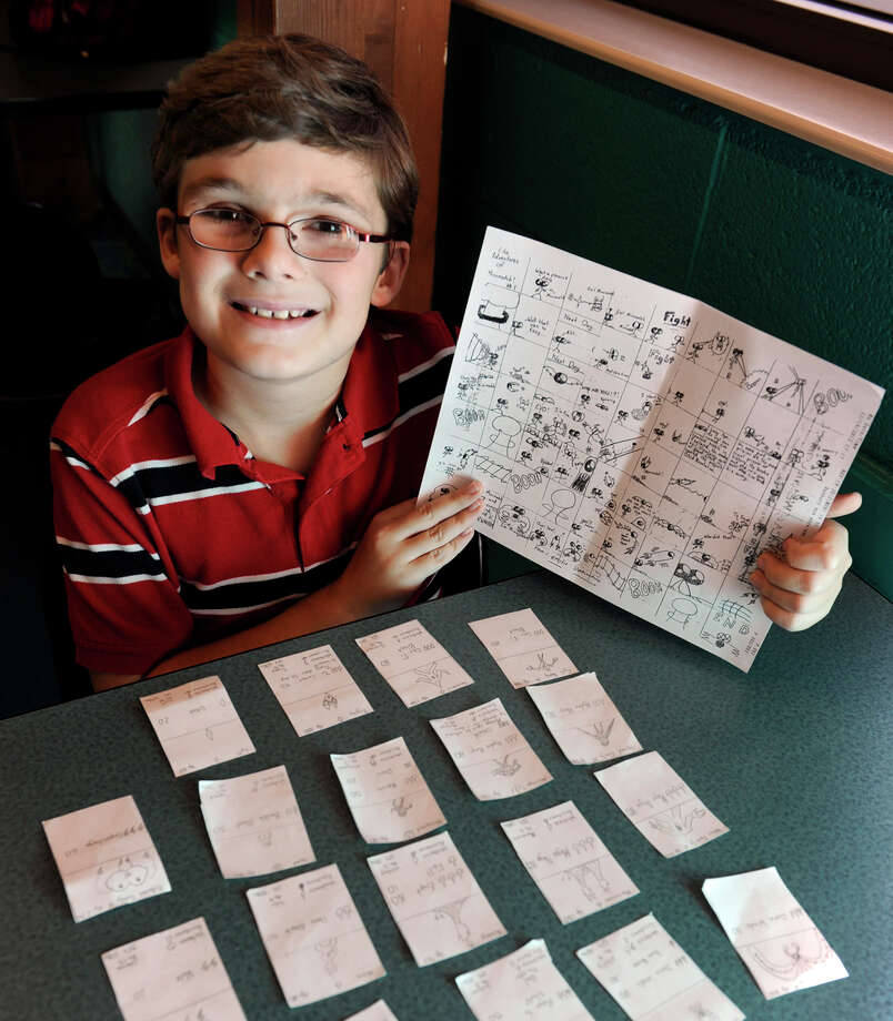 Emilio Diamantini, 10, of Brookfield, is photographed with some of his cartoons, Tuesday, Dec. 4, 2012. Photo: Carol Kaliff / The News-Times
