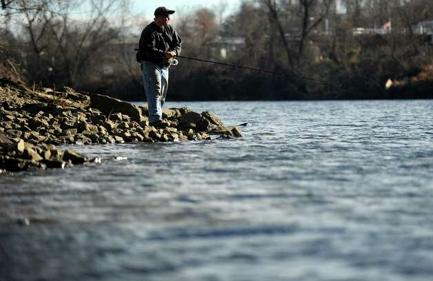 Ted MacKenzie, of Belchertown , MA, waits for a bite while fishing along the Housatonic River in Derby, Conn. Wednesday, Dec. 5, 2012. Photo: Autumn Driscoll / Connecticut Post