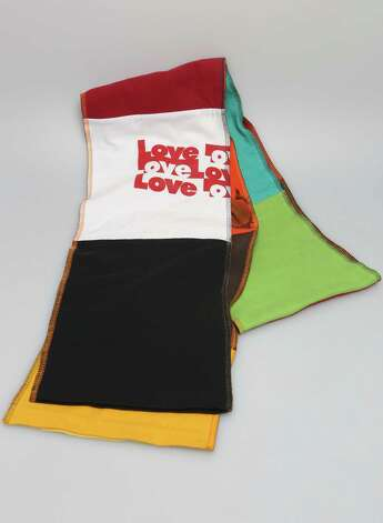 Recycled T-shirt Love scarf by local artist Ray Chavez, $18, at On Main/Off Main Photo: Helen L. Montoya, San Antonio Express-News / ©2013 San Antonio Express-News