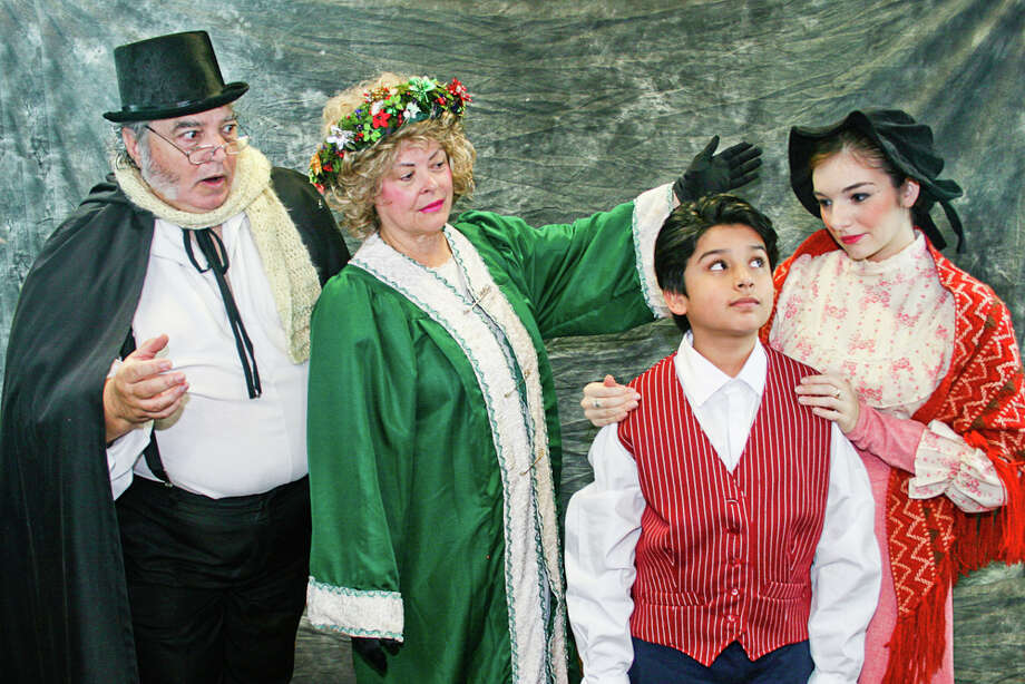 "Mike Cedro, from left, Janet Elayne Harris, Hadeed Ahmed and Luci Galloway portray Ebenezer Scrooge, Ghost of Christmas Past, young Ebenezer, and Fanny Scrooge in ""Bah, Humbug."