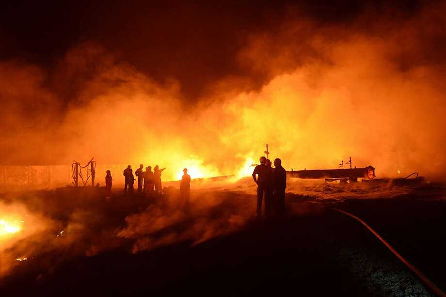Pipeline inferno:Rescue workers attempt to control a major fire that erupted along the Indian Oil Corporation's Crude Oil Pipeline in Rutadal village, some 55 miles from Ahmedabad. Three persons were injured in the blaze and sent to a hospital. The fire was under investigation. Photo: Sam Panthaky, AFP/Getty Images