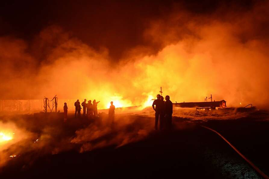 Pipeline inferno: Rescue workers attempt to control a major fire that erupted along the India