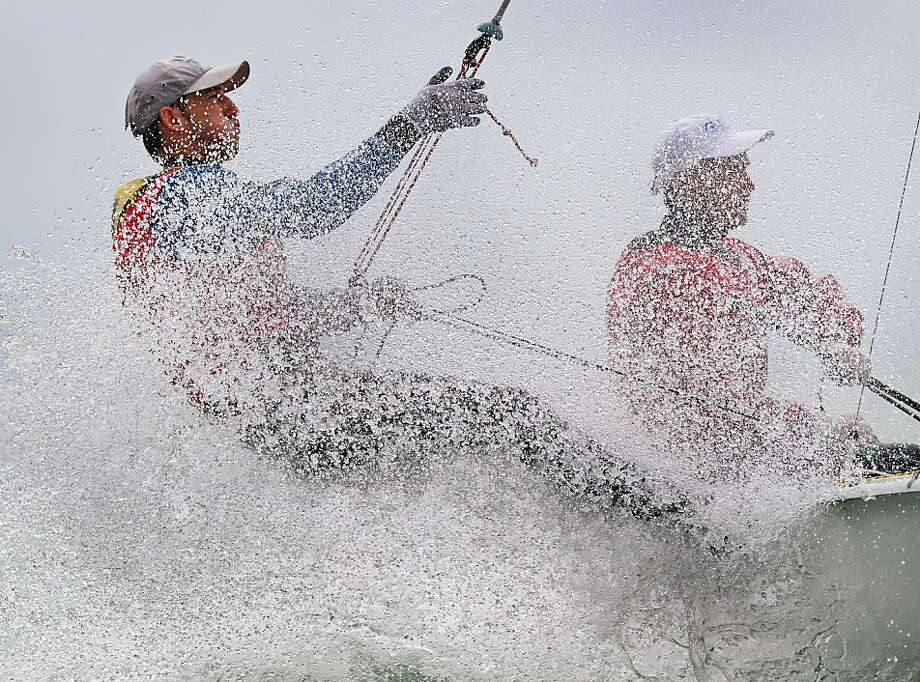 Spray showers sailors Vladimir Chaus and Denis Gribanov of Russia as they skim over the waves in the 470 Men's class at the ISAF Sailing World Cup in Melbourne. Photo: William West, AFP/Getty Images