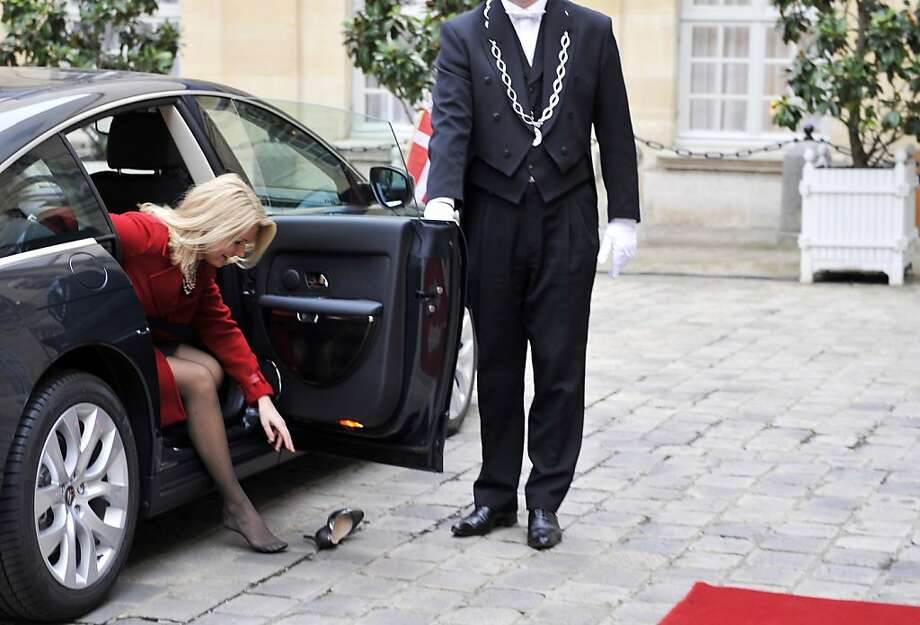 Never a Prince Charming when you need one: Denmark Prime Minister Helle Thorning-Schmidt loses a shoe while getting out of her car at the Elysee Palace in Paris. Photo: Mehdi Fedouach, AFP/Getty Images