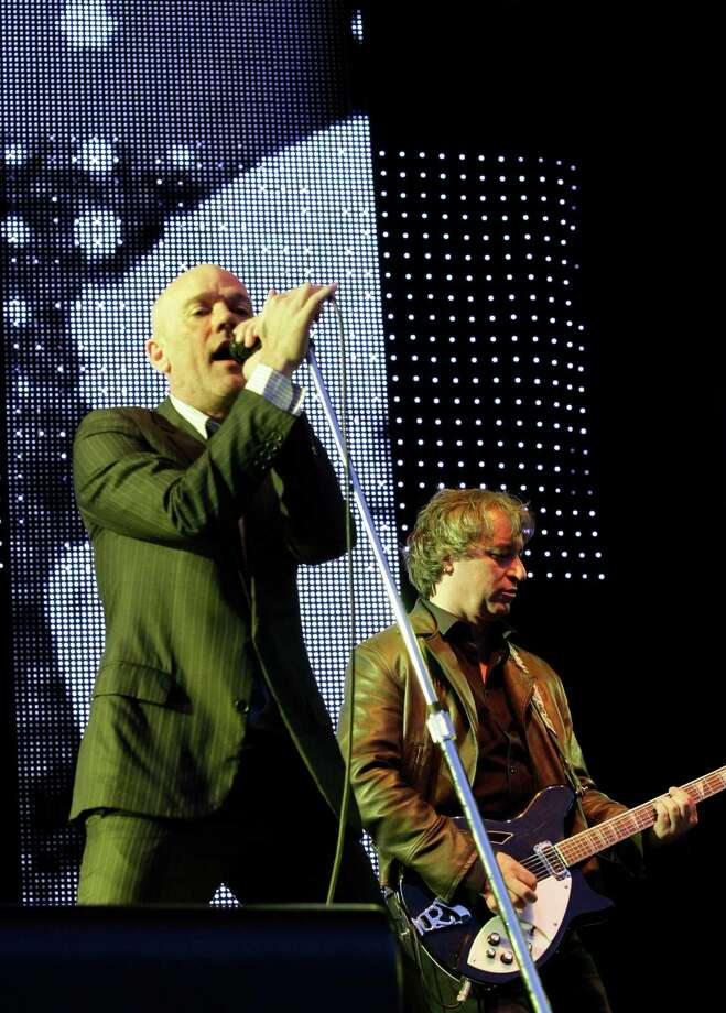 FILE - In this July 15, 2008 file photo, U.S. rock band R.E.M. with singer Michael Stipe, left, and guitarist Peter Buck, right, perform at an open air concert in Dresden, eastern Germany. The band announced Wednesday, Sept. 21, 2011 on their website that they are breaking up.  (AP Photo/Matthias Rietschel, file) Photo: MATTHIAS RIETSCHEL / AP2008