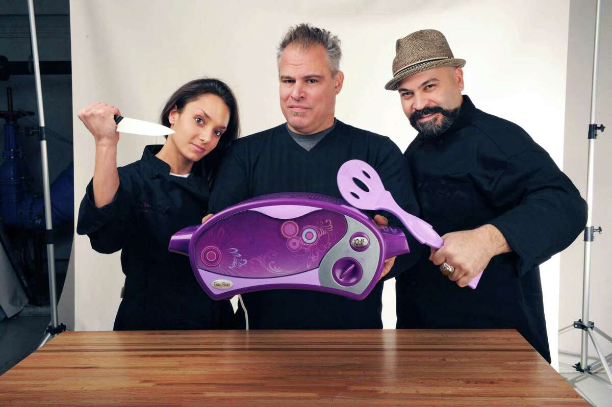 Chefs, from left, Roslyn Zecchini, executive chef, Boca Bistro, Saratoga Springs, Ric Orlando, executive chef-partner, New World Bistro Car, Albany and Dimitrios Menagias, executive chef, The City Beer Hall, Albany with an Easy-Bake oven in the Times Union studio Wednesday Nov. 28, 2012. (John Carl D'Annibale / Times Union)