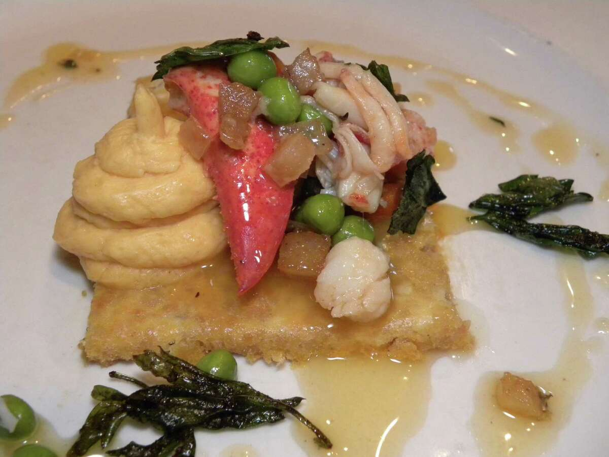 STEVE BARNES/TIMES UNION Ric Orlando's lobster-Gorgonzola dacquoise with lobster salad and lobster-Gorgonzola buttercream.