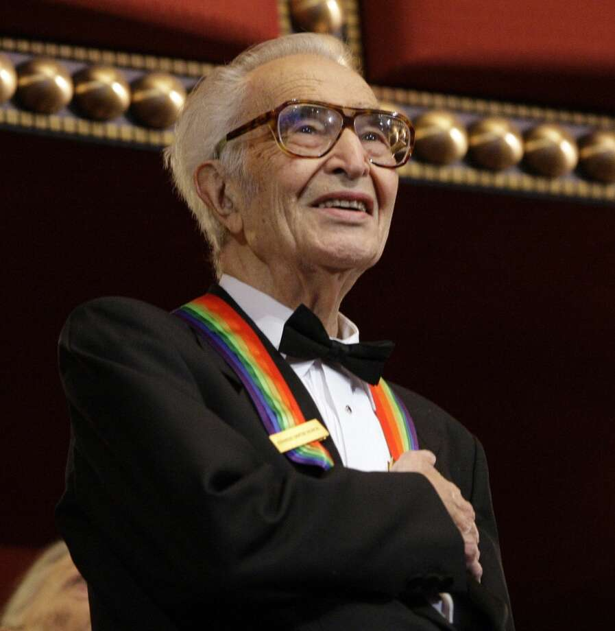 FILE - In this Dec. 6, 2009 file photo, Kennedy Center honoree Dave Brubeck stands for the National Anthem at the Kennedy Center Honors gala in Washington. (Associated Press)
