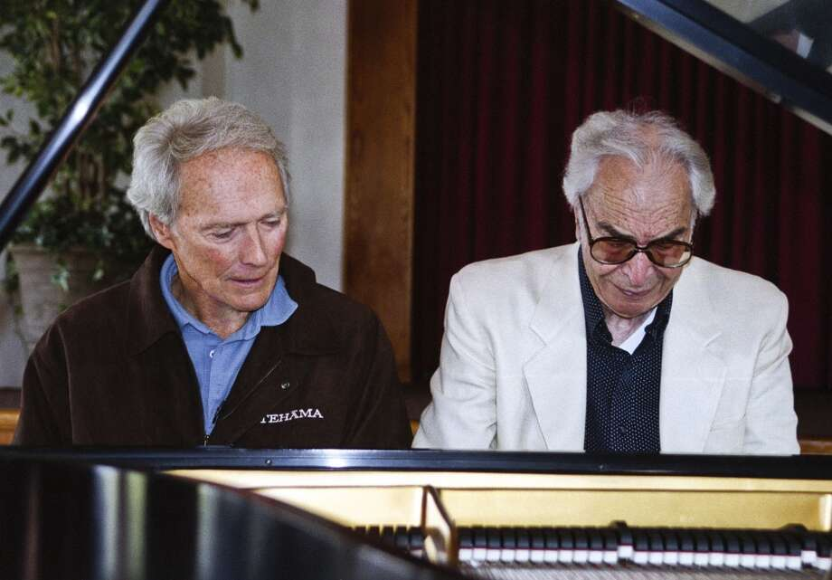 In this undated photo provided by Hank O'Neal, pianist Dave Brubeck, right, sits beside actor and producer Clint Eastwood in 2010. (Associated Press)