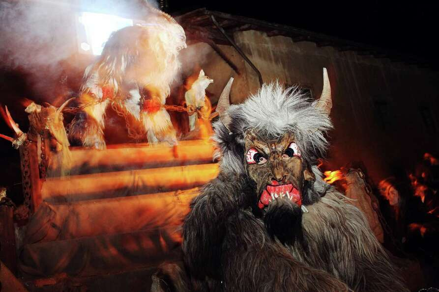 People dressed as demonic creatures take part in a Krampus procession on December 4, 2011 in Prad ne