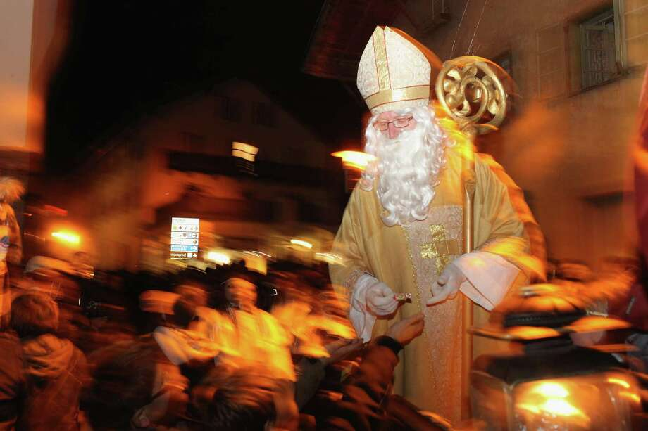 People dressed as Saint Niklas take part in a Krampus procession on December 4, 2011 in Prad near Merano, Italy. Photo: Johannes Simon, Getty / 2011 Getty Images