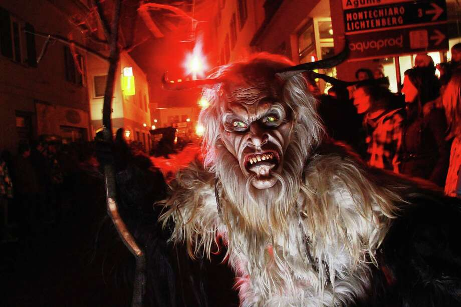 People dressed as demonic creatures take part in a Krampus procession on December 4, 2011 in Prad near Merano, Italy. Photo: Johannes Simon, Getty / 2011 Getty Images