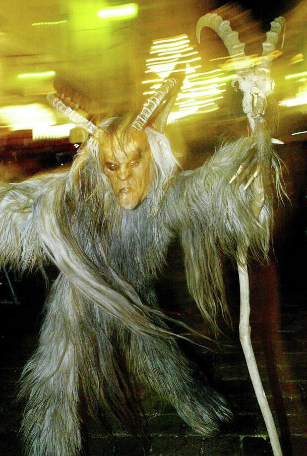 Austria: Krampus, St. Nicholas helperKrampus, the terrifying companion of St. Nicholas and one of Austria's unique Advent traditions, is seen during a traditional Krampus procession in the city of Hallein in Salzburg. Photo: MARTIN SCHALK, AP / AP