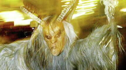 Krampus, the terrifying companion of St. Nicholas and one of Austria's unique Advent traditions, is seen during a traditional Krampus procession in the city of Hallein in Salzburg.