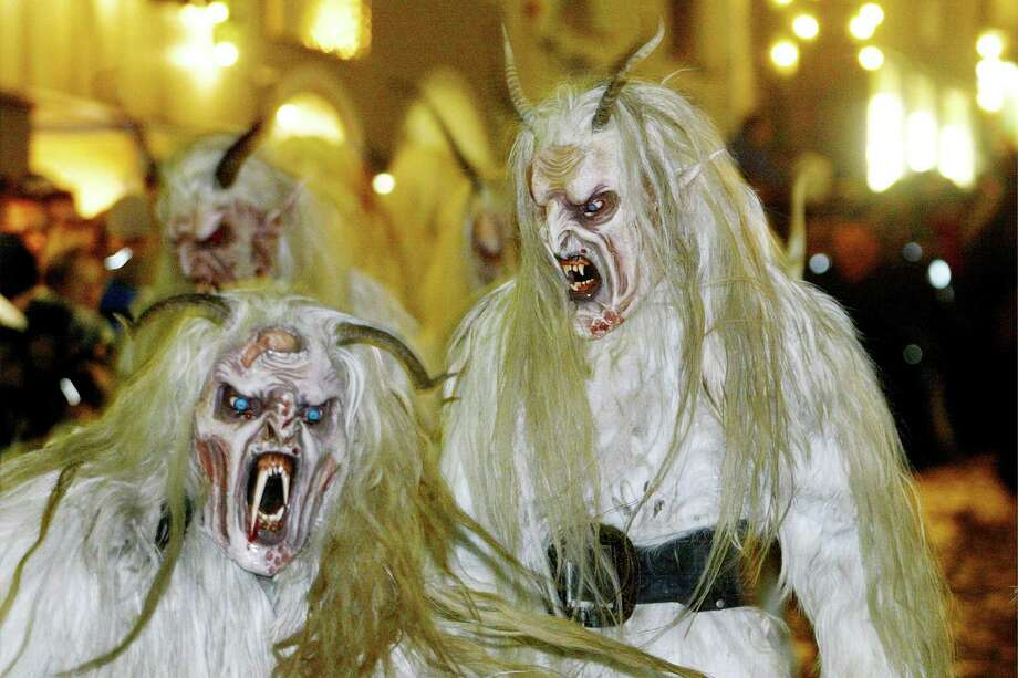 Krampusses, the terrifying companions of St. Nicholas and one of Austria's unique Advent traditions, are seen during a traditional Krampus procession in the city of Hallein in Salzburg province. Photo: MARTIN SCHALK, AP / AP