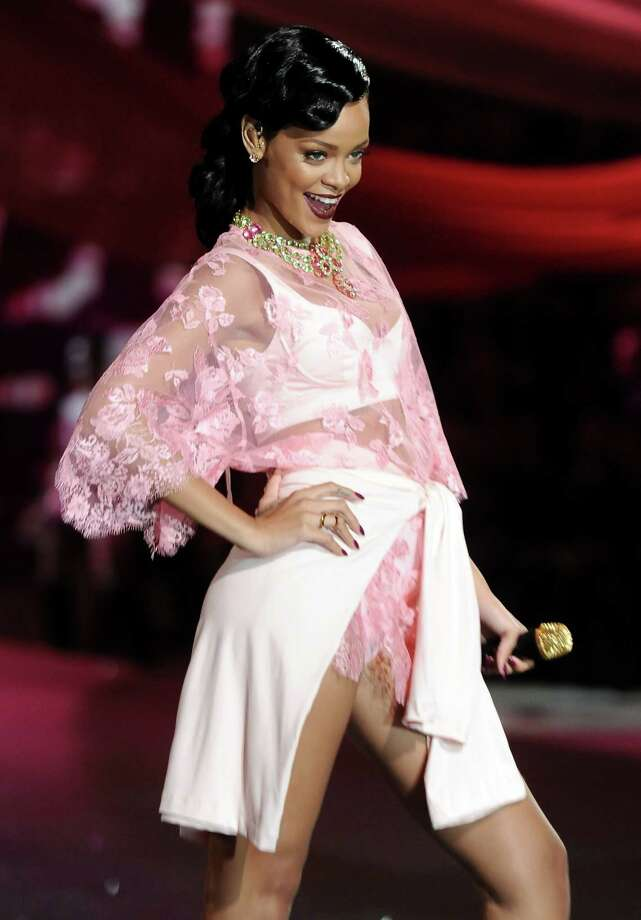 "FILE - This Nov. 7, 2012 file photo shows singer Rihanna during the 2012 Victoria's Secret Fashion Show in New York. Rihanna has signed on to executive produce the new series ""Styled to Rock"" for the Style network. The 10-episode series set to air in 2013 will give 12 aspiring designers, chosen by Rihanna, an opportunity to style A-list stars. (Photo by Evan Agostini/Invision/AP, file) Photo: Evan Agostini"