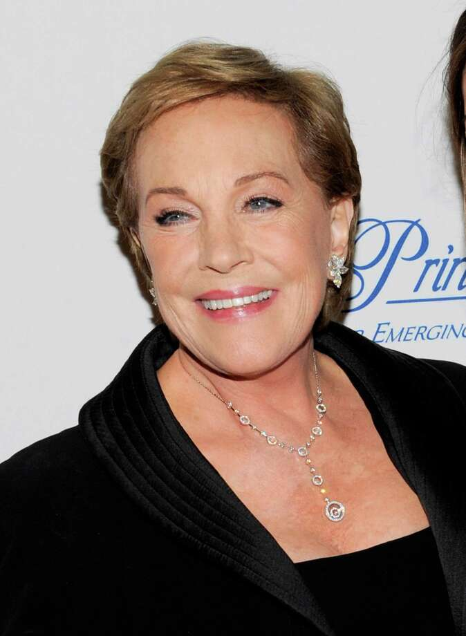 "FILE - This Nov. 1, 2011 file photo shows Julie Andrews at the Princess Grace Foundation Awards gala in New York. The Oscar and Tony Award-winning actress said that a botched operation to remove non-cancerous throat nodules in 1997 hasn't gotten better. It has permanently limited her range and her ability to hold notes. ""The operation that I had left me without a voice and without a certain piece of my vocal chords,"" said Andrews, who starred in such quintessential stage and film musicals as ""The Sound of Music,"" ""My Fair Lady"" and ""Mary Poppins."" (AP Photo/Evan Agostini, file) Photo: Evan Agostini"