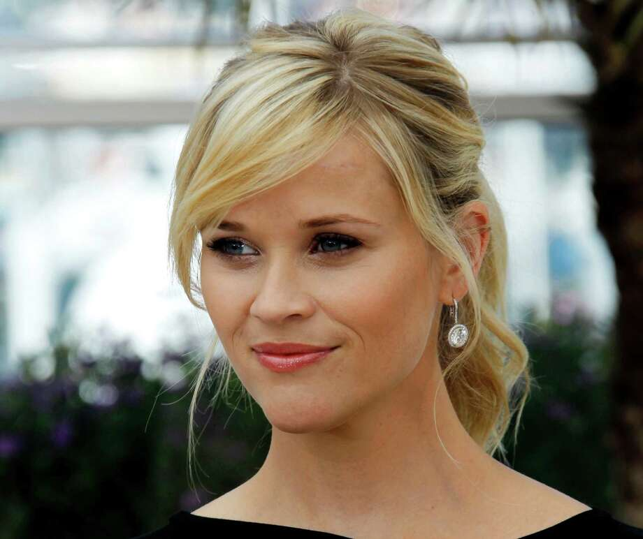 "FILE - This May 26, 2012 file photo shows actress Reese Witherspoon posing during a photo call for ""Mud"" at the 65th international film festival, in Cannes, southern France. The 36-year-old Oscar winner and mother of three will receive the March of Dimes Grace Kelly Award at its Celebration of Babies luncheon Friday Dec. 7, 2012 at the Beverly Hills Hotel.  (AP Photo/Joel Ryan, file) Photo: Joel Ryan"