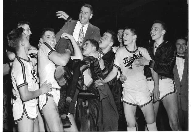 The New England champion Roger Ludlowe Flying Tigers lift their coach Bob Scirup after claiming the New England Interscholastic championship in Boston in 1955. Photo: Contributed Photo