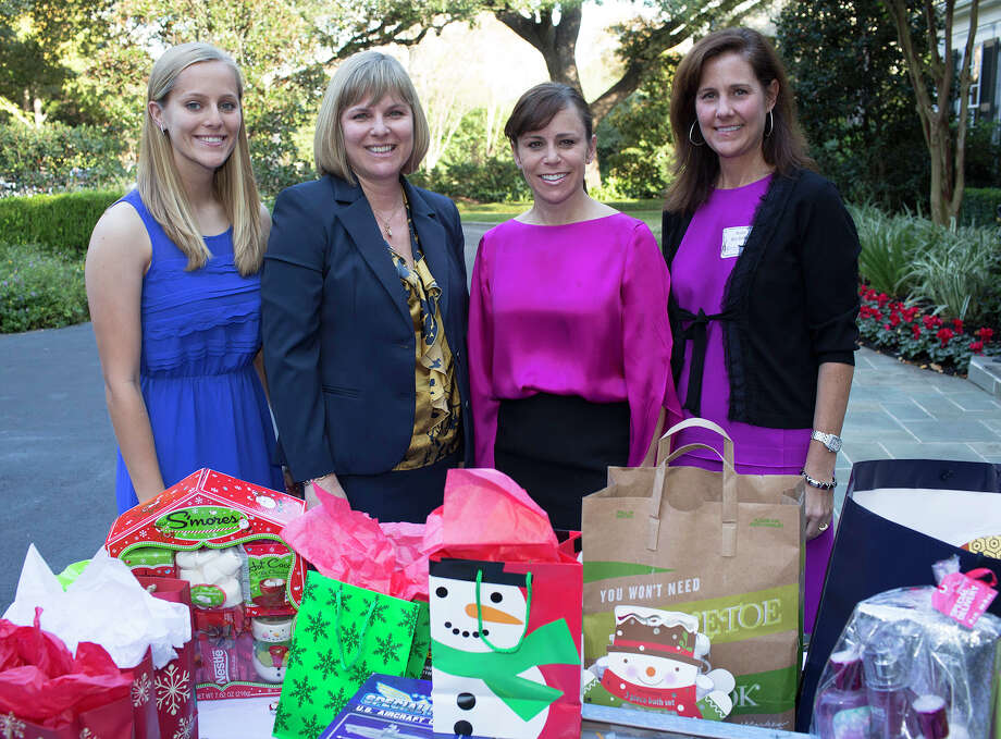 National Charity League Rose Chapter Teddy Bear Tea: High school  senior Sydney Kranzmann (from left) and Operation Home Front liaison  Holly Kranzmann get together with President Susanne Marco and Vice  President of Philanthropy Anne Rochelle during the  tea benefiting  Operation Home Front at the home of Leigh Ann King. Photo: J.Michael Short, For The Express-News / THE SAN ANTONIO EXPRESS-NEWS