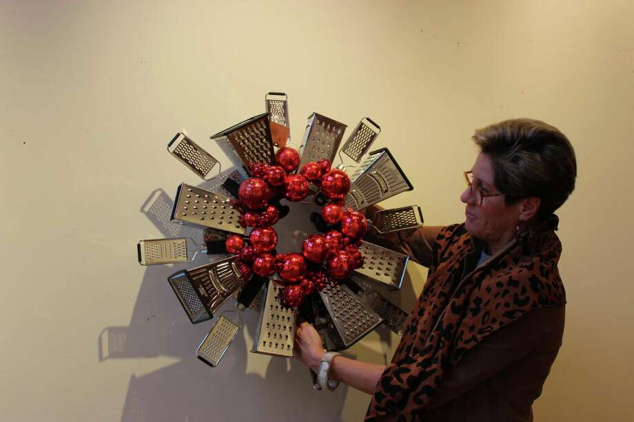 Darien Nature Center Executive Director, Lynn Hamlen, hanging a wreath, Seasons Gratings. Dec. 3, 2012 Photo: Megan Davis