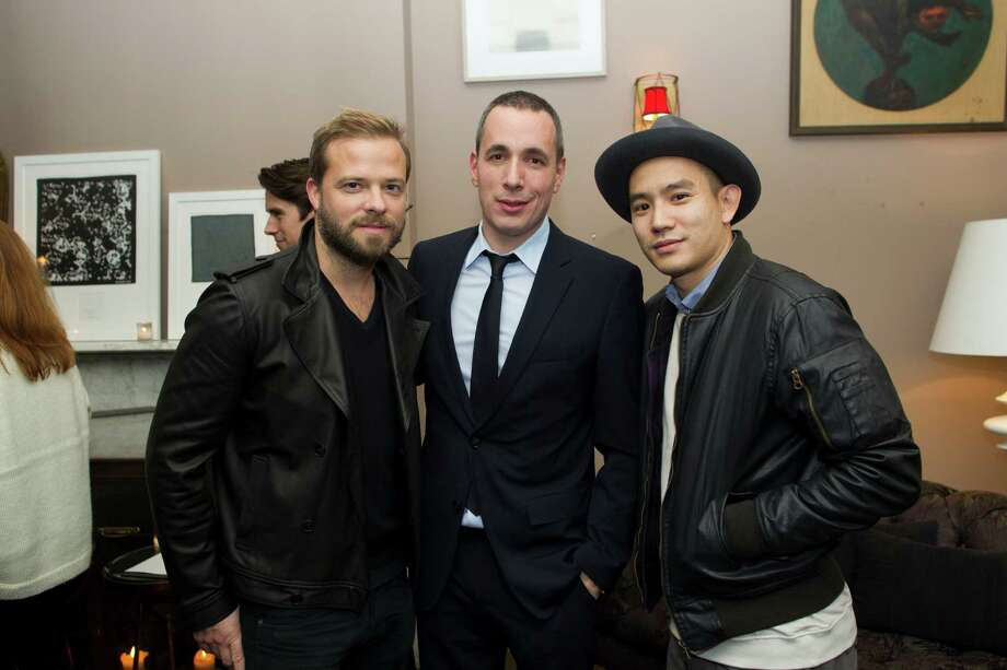 IMAGE DISTRIBUTED FOR DETAILS - Simon Spurr, left, Dan Peres, editor and chief of DETAILS, and Eugene Tong, right, are seen at Launch of DETAILS x CFDA Menswear Initiative, on Tuesday, Dec. 4, 2012, in New York.  (Photo by Victoria Will/Invision for DETAILS/AP Images) Photo: Victoria Will