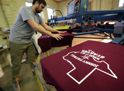 Scott Klingle prints shirts at BeBop T-Shirt Shop to be worn Saturday night during a celebration at the Wing King restaurant. Photo: Bob Owen, San Antonio Express-News / © 2012 San Antonio Express-News